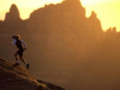 Woman Runs Up a Red Rock Slope, Sedona, Arizona, United States
