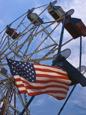 Flag in Front of a Ferris Wheel Against a Summer Sky, New London, Connecticut, USA