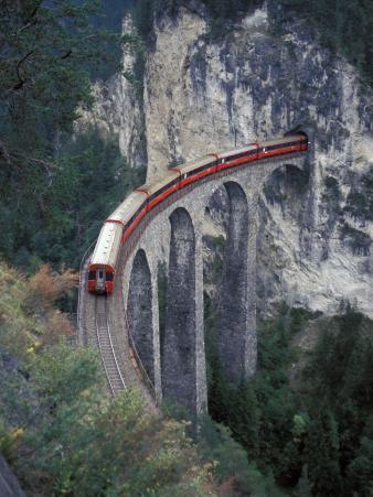 Passenger Train on Rock Bridge, Switzerland