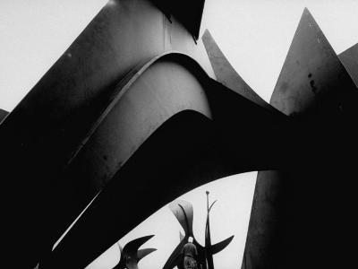 Sculptor Alexander Calder Standing with Giant Iron Sculptures Outside His Studio, Sache, France