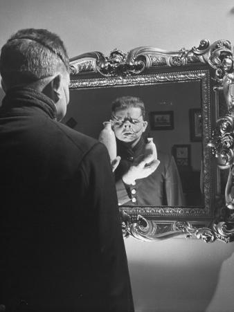 Cartoonist Charles Addams Experimenting with Scary Faces for His Cartoon, The Addams Family