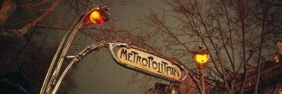 View of a Signboard of a Subway Station Lit Up at Night, Paris, France