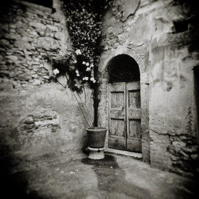 Corner of Quiet Square in Village of Lucignano D'Asso, Tuscany, Italy
