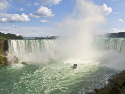 Maid of the Mist Tour Boat under the Horseshoe Falls Waterfall at Niagara Falls, Ontario, Canada