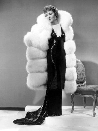 Claudette Colbert, in Travis Banton Gown and White Fox Fur Coat, c.1935