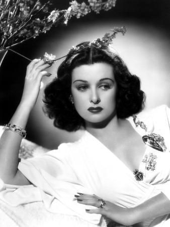 She Knew All the Answers, Joan Bennett, Reclining and Touching a Flower, 1941