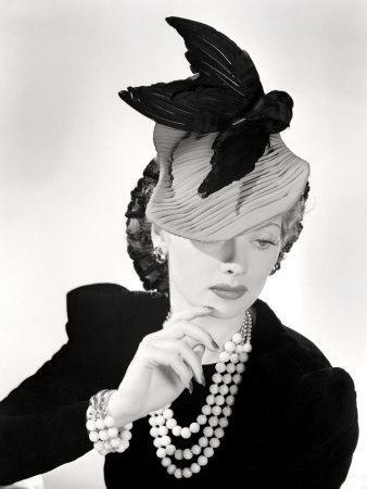 Lucille Ball Models a Unique Hat for a Publicity Still, 1940's