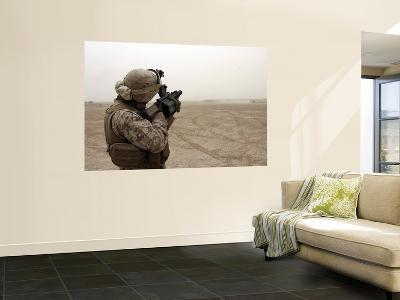A Grenade from a M-32 Grenade Launcher Appears as a Speck Against a Bleak Sandstorm Sky