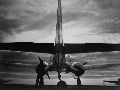 World War II, Soldier Beside WWII Airplane at Sunrise, Early 1940s