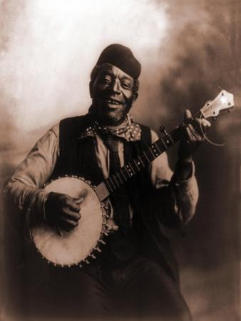 African American Man Seated and Holding Banjo, 1911