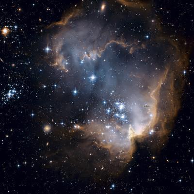 Bright blue newborn stars blast a hole through a nearby dwarf galaxy
