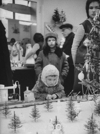 Little Boy Looking at Train Set in Moscow Department Store