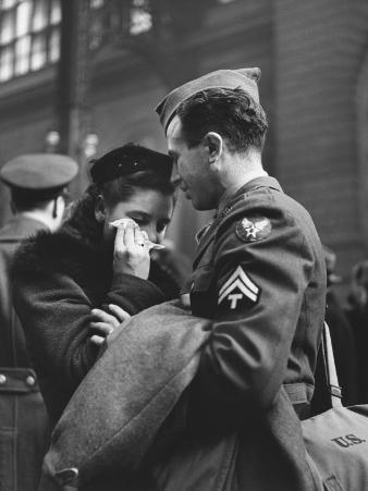 Soldier Consoling Wife as He Says Goodbye at Penn Station before Returning to Duty, WWII