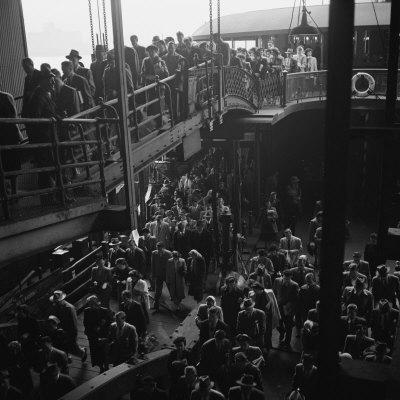 Ferry Boat Commuters from Staten Island Disembarking at Ferry Slip in Manhattan