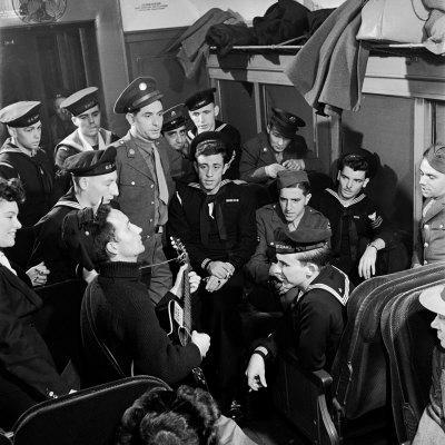 Activist Folk Musician Woody Guthrie Playing for a Group of Servicemen During WWII