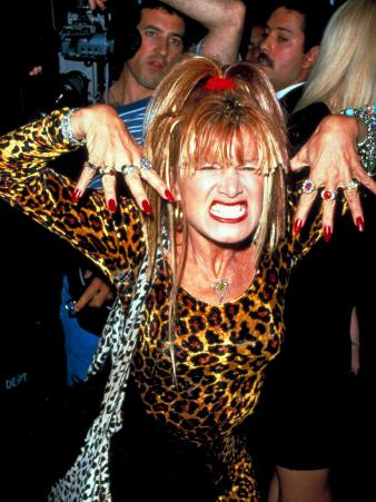 Designer Betsey Johnson Baring Teeth in Cat Pose at Party for Helmut Newton, Barneys Clothing Store