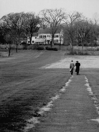 Distant of Mathematicians Albert Einstein and Kurt Godel Taking a Walk
