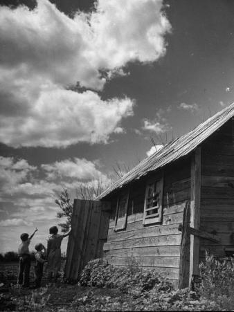Children Searching the Sky Looking for Rain Clouds Outside Farmhouse During Drought in the Midwest