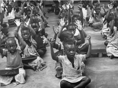 Children Raising their Hands in the Air During Kipuchi Kindergarten Classes