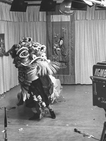 Chinese Boy in Costume Reciting before TV Cameras