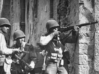 American Soldiers Firing Back at Unseen German Sniper During the Battle for Cisterna