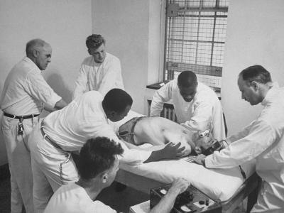 Patient, Surrounded by Men in White, Receiving Electric Shock Treatment