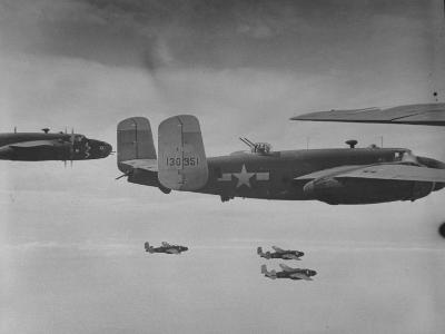 Flight of American B-25 Mitchell Bombers Enroute to a Bombing Mission over the Port of Madang