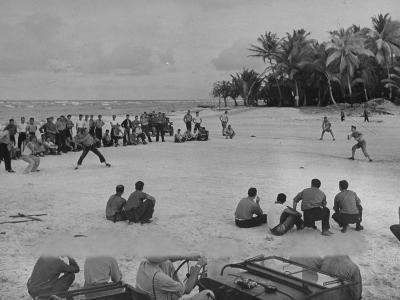 American Servicemen Playing Softball on an Idle Stretch of Runway While Other Soldiers Look On