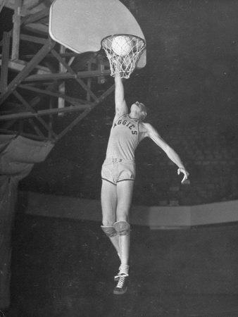 Texas A&M Basketball Player Bob Kurland Reaching to Make a Basket