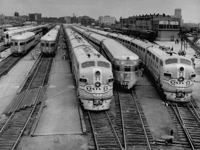 """Men are Loading Up the """"Santa Fe"""" Train with Supplies before They Take-Off"""