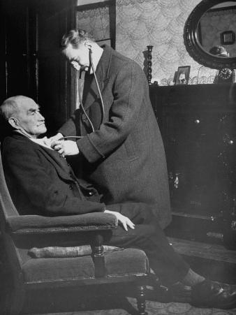 Doctor Making a House Call to an Ill Elderly Man, Listening to the Rhythm of His Heart