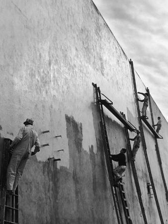 Men on Ladders Painting Exterior Wall of Building in Preparation for Opening of the World's Fair