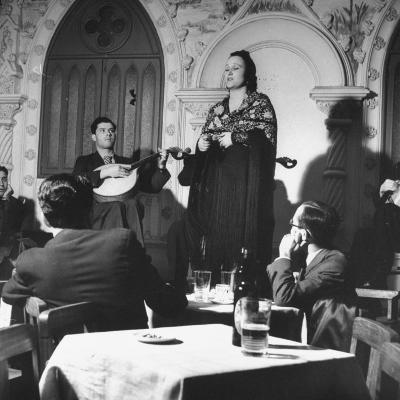 """""""Fado"""" Singer and a Guitarist Entertaining the Audience in the Lisbon Nightclub"""