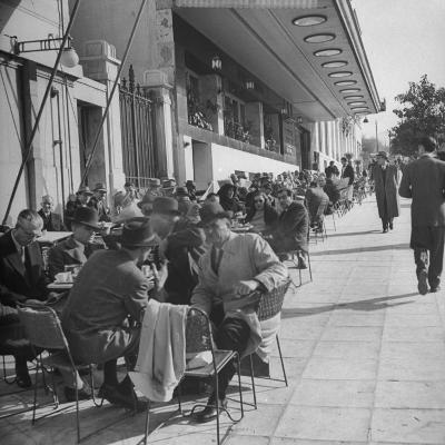 Crowds of People Eating at Outdoor Cafe