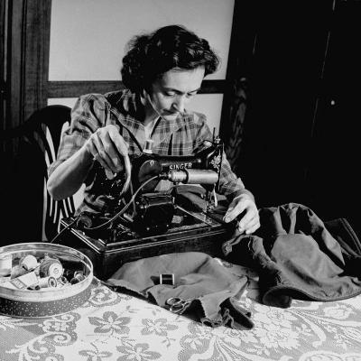 Mrs. Milton D. Phillips Sewing Clothes for Her Family to Stretch the Budget