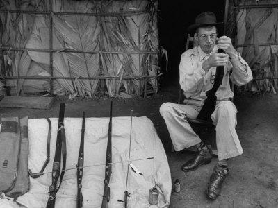"Film Director John Huston, Playing with Rifles During the Making of the Movie ""The African Queen"""