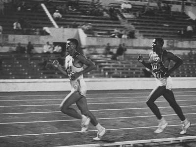 US Rafer Johnson and Nat. China Yang Chuan Kwang During Running Event at Olympics