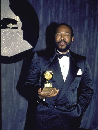 Singer Marvin Gaye Holding His Award in Press Room at Grammy Awards