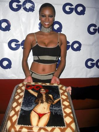 Model Tyra Banks Holding Cake with Her Likeness at Gq Magazine Party