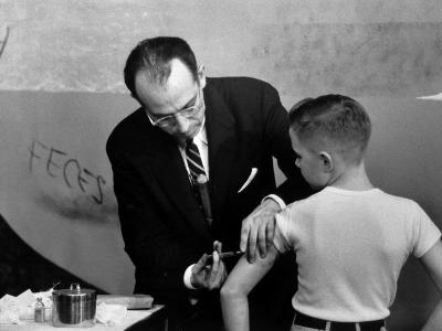 Dr. Jonas Salk Inoculating a Young Boy W. His New Polio Vaccine
