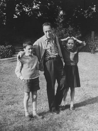 French Author Albert Camus Poised Standing on Lawn, Arms around His Twins Jean and Catherine