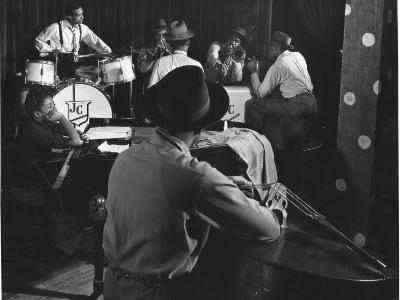 Singer Sarah Vaughn Sitting at Piano While the J. C. Heard Orchestra Plays During Rehearsal