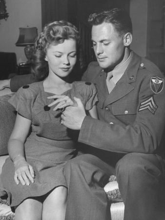 Actress Shirley Temple, and Sgt. John Agar, Looking at the Ring on Her Finger