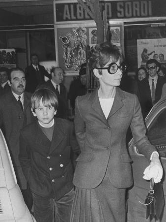 Actress Audrey Hepburn Leaving Movie Theater with 9-Yr-Old Son Sean Ferrer