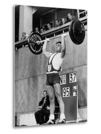 Iranian Weight Lifter M. Namdjou Struggling to Hold Up 206.5 Pound Weight at 1952 Olympics