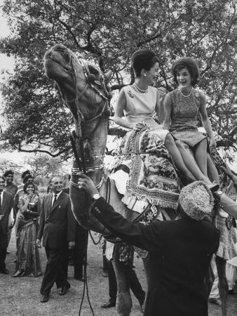Mrs. John F. Kennedy and Princess Stanislas Radziwill Riding Camel