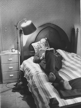 Author Vladimir Nabokov Writing While Lying on His Bed at Home