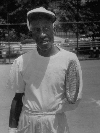 Althea Gibson's Tennis Instructor, Fred Johnson Holding Tennis Racket by Arm Stump, at Public Court
