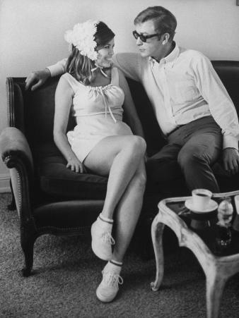 British Actor Michael Caine Talking with an Unknown Woman