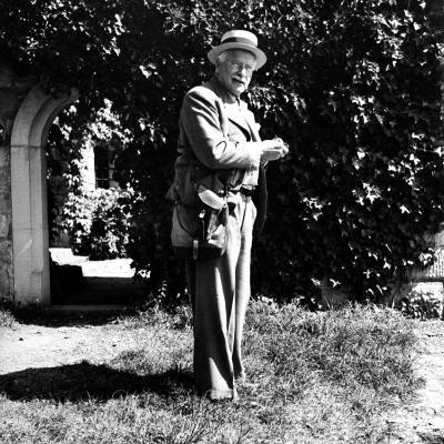 Swiss Psychiatrist Dr. Carl Jung Standing in Garden Outside His Home
